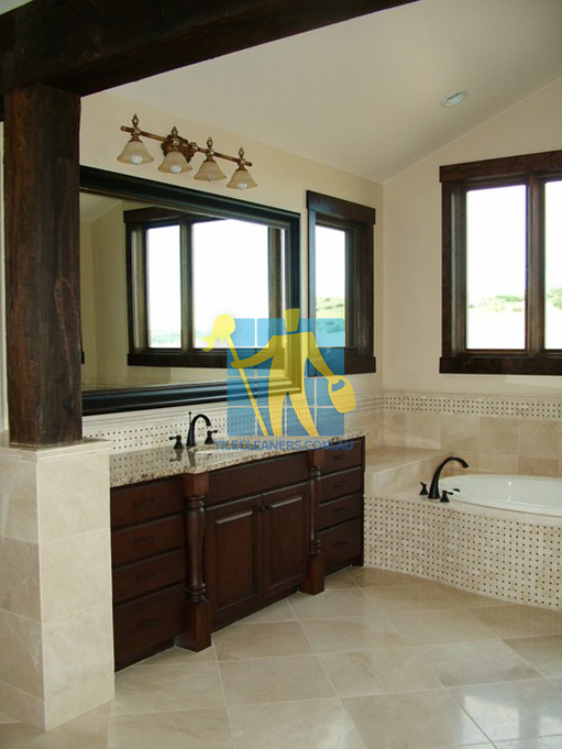 Traditional Bathroom With Shiny Stone Tiles And Mosaic Bath Tub Sides  Wooden Cabinets Melbourne
