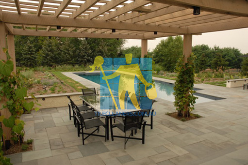 bluestone tiles outdoor around contemporary pool light copping