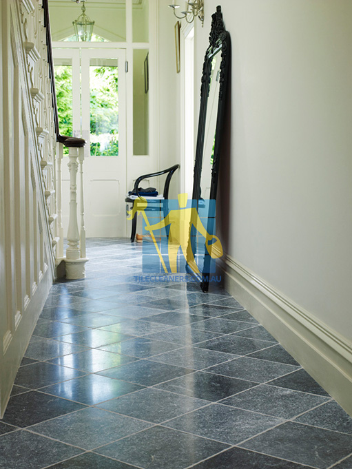 Sunshine Coast bluestone tumbled tile indoor hallway white grout