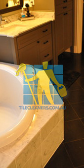 traditional bathroom with black granite tiles on the floor Melbourne
