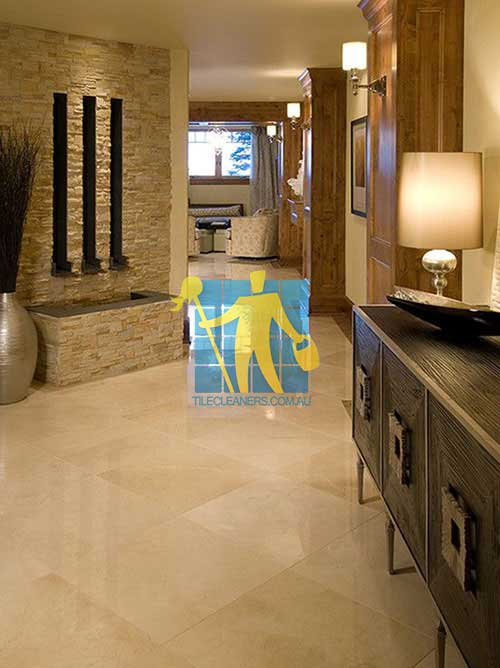home with shiny limestone tile floor