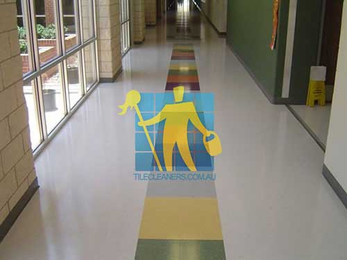 white and coloured vinyl tile school floor