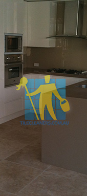 kitchen with clean porcelain floor tiles after cleaning by tile cleaners Perth