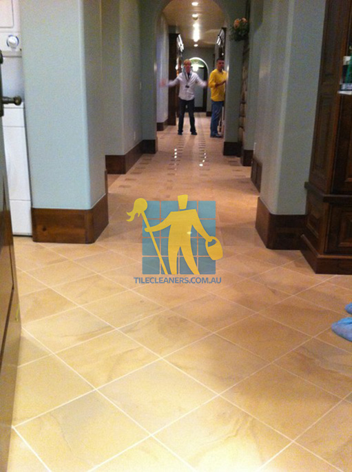 traditional entry with large porcelain tiles were laid in a basketweave pattern