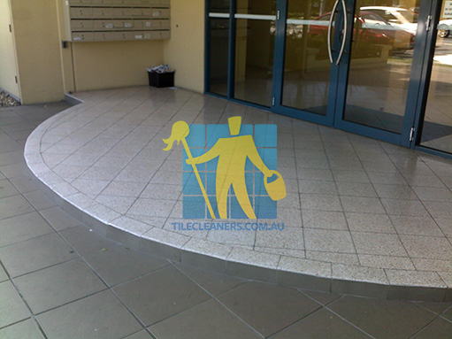 terrazzo tiles building entrance empty before cleaning angle shot dirty
