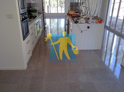 terrazzo tiles indoors large room large windows shodow during cleaning