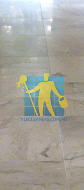 close shot of travertine tiles in large empty livingtoom large tiles after cleaning Sydney
