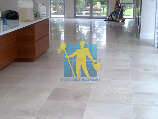 travertine tiles in large empty livingtoom large tiles after cleaning with machines in back
