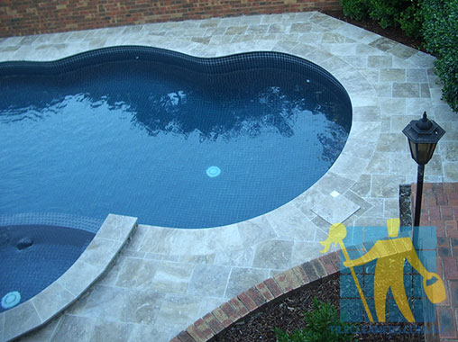 cleaned outdoor pool travertine_tiles